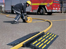 Laying a cable using hose ramp