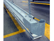 Steel crash barrier combination with ahandrail, steel mesh infill and a kick rail. Steel swirl ends because of pedestrian traffic.