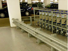Steel crash barrier can be terminated safety between concrete pillars as at the new multi- storey car park at St. Pancras Railway Station.