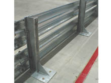 Bolt down galvanised steel posts are securely fixed with anchor bolts to a concrete deck.