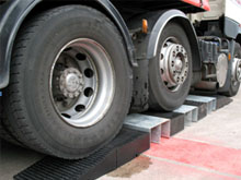 Extra deep protectors will take the weight of the largest HGVs. The photo shows a large truck driving over an assembled rubber and steel HR7 ramp.