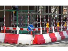 You can add barrier boards, signage and warning lights to an installation of traffic separators for extra awareness for drivers
