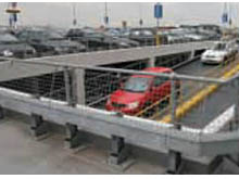 There is an alternative to spring steel a flexi post with a rubber lined floor mounted metal socket. For crash barrier, box section or warehouse rail.
