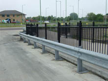 Crash barrier is ideal for 'off the highway' installations, in this case to protect an expensive looking fence.