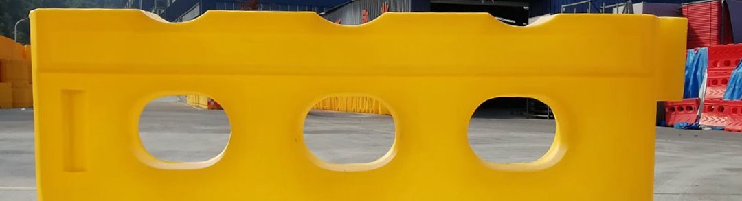 Yellow plastic safety barrier